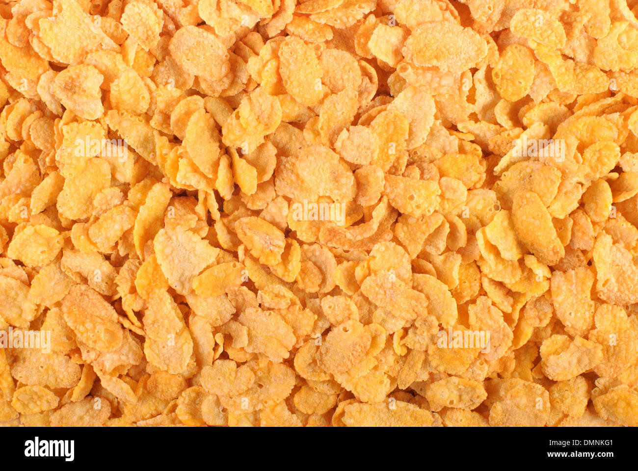 Corn flakes background. Top view - Stock Image