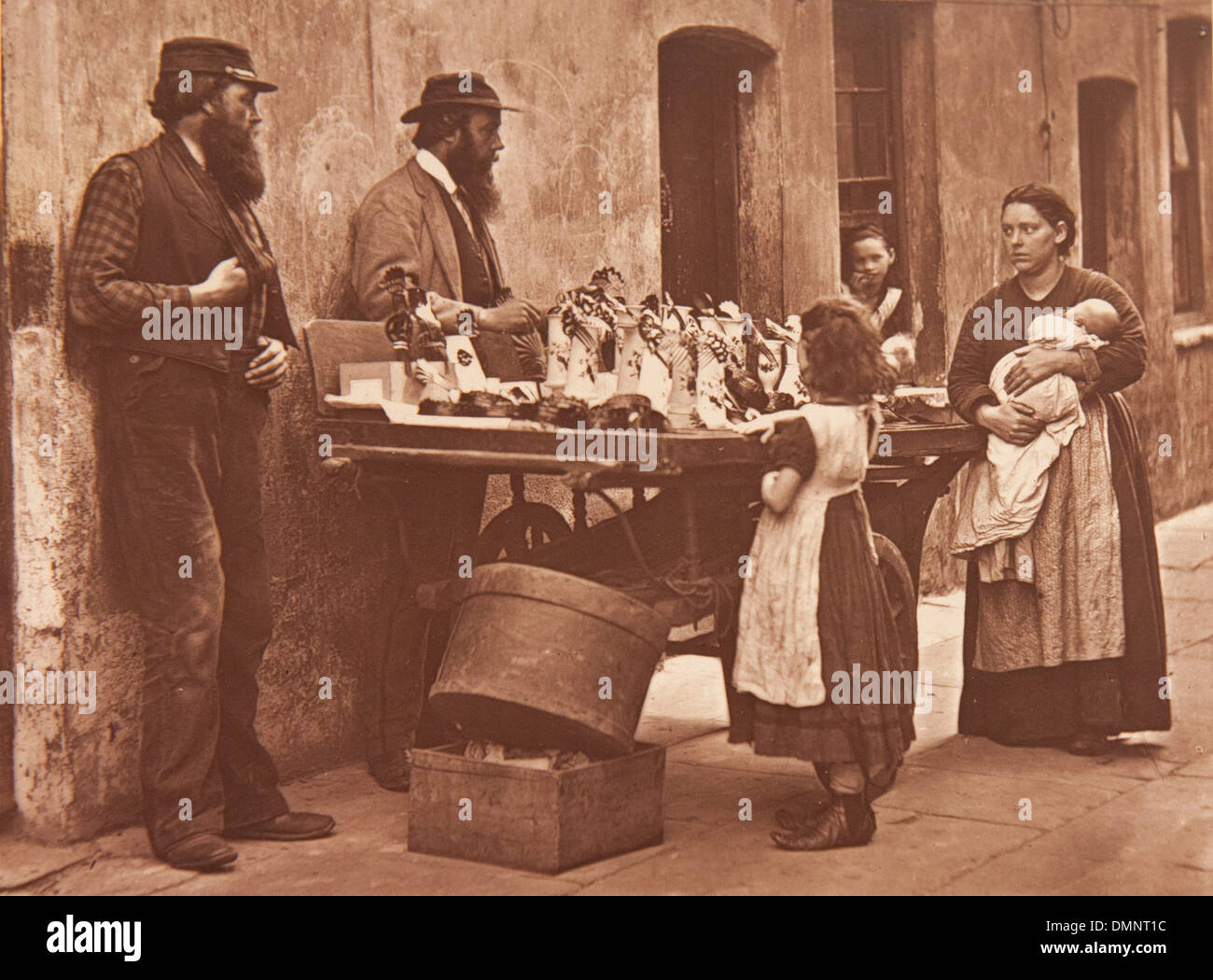 Photograph showing 'Dealer in fancy ware' (jeweley, imitating gems and ornaments) in the Street Life in London book - Stock Image