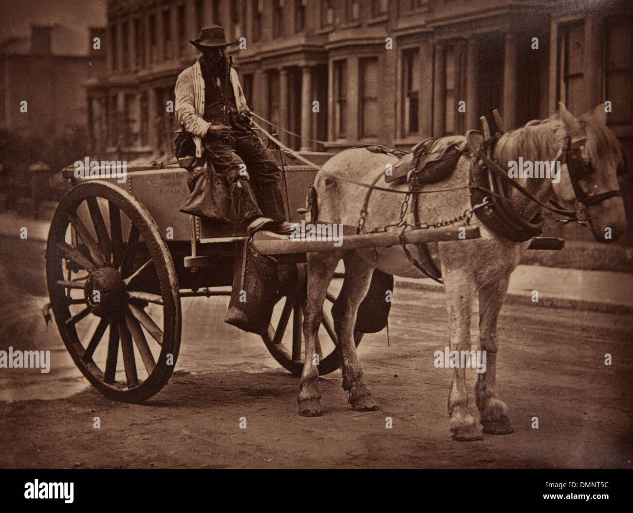 Photograph showing 'The Water-Cart' in the Street Life in London book - Stock Image