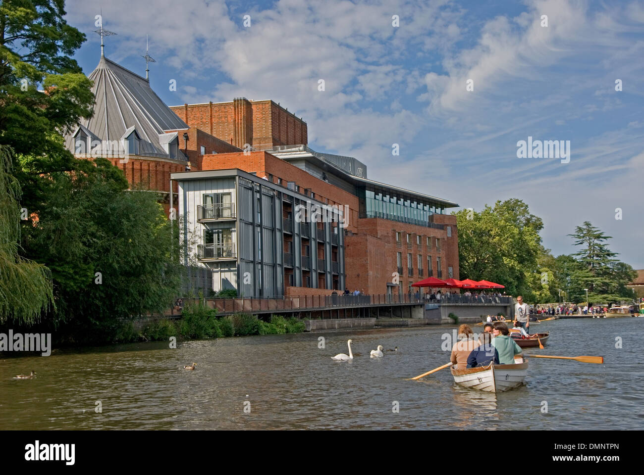 Stratford upon Avon and the Royal Shakespeare Theatre and rowing boats on the River Avon, Warwickshire. - Stock Image