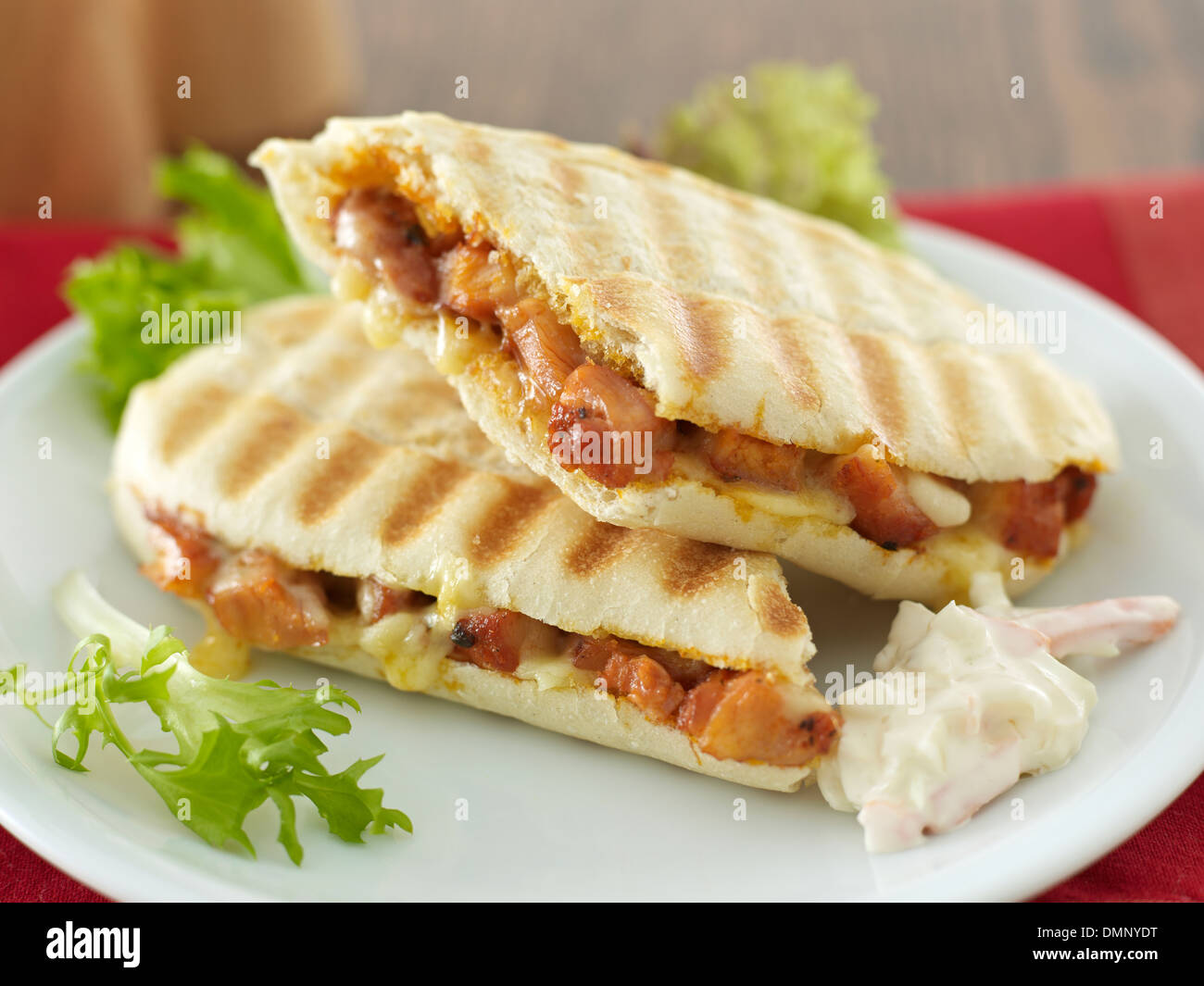 food fried chicken and cheese panini and coleslaw sandwich - Stock Image
