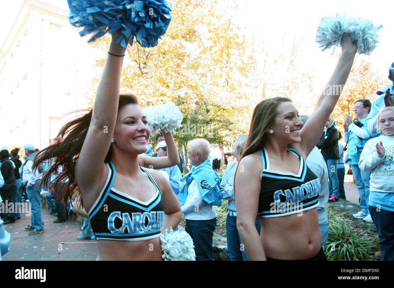 Nov. 07, 2009 - Chapel Hill, North Carolina, U.S - November 7, 2009: UNC cheerleaders greet fans at the pregame ''Well Walk'' from the Old Well to Kenan Stadium two hours prior to the game against Duke.  The University of North Carolina Tarheels played the Duke Blue Devils at Kenan Stadium in Chapel Hill, North Carolina (Credit Image: © Margaret Bowles/Southcreek Global/ZUMApress.c - Stock Image