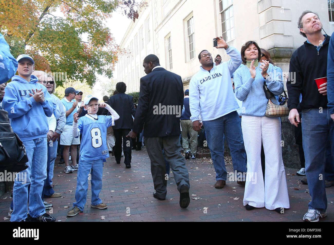 Nov. 07, 2009 - Chapel Hill, North Carolina, U.S - November 7, 2009: UNC players greet fans at the pregame ''Well Walk'' from the Old Well to Kenan Stadium two hours prior to the game against Duke.  The University of North Carolina Tarheels played the Duke Blue Devils at Kenan Stadium in Chapel Hill, North Carolina (Credit Image: © Margaret Bowles/Southcreek Global/ZUMApress.com) - Stock Image