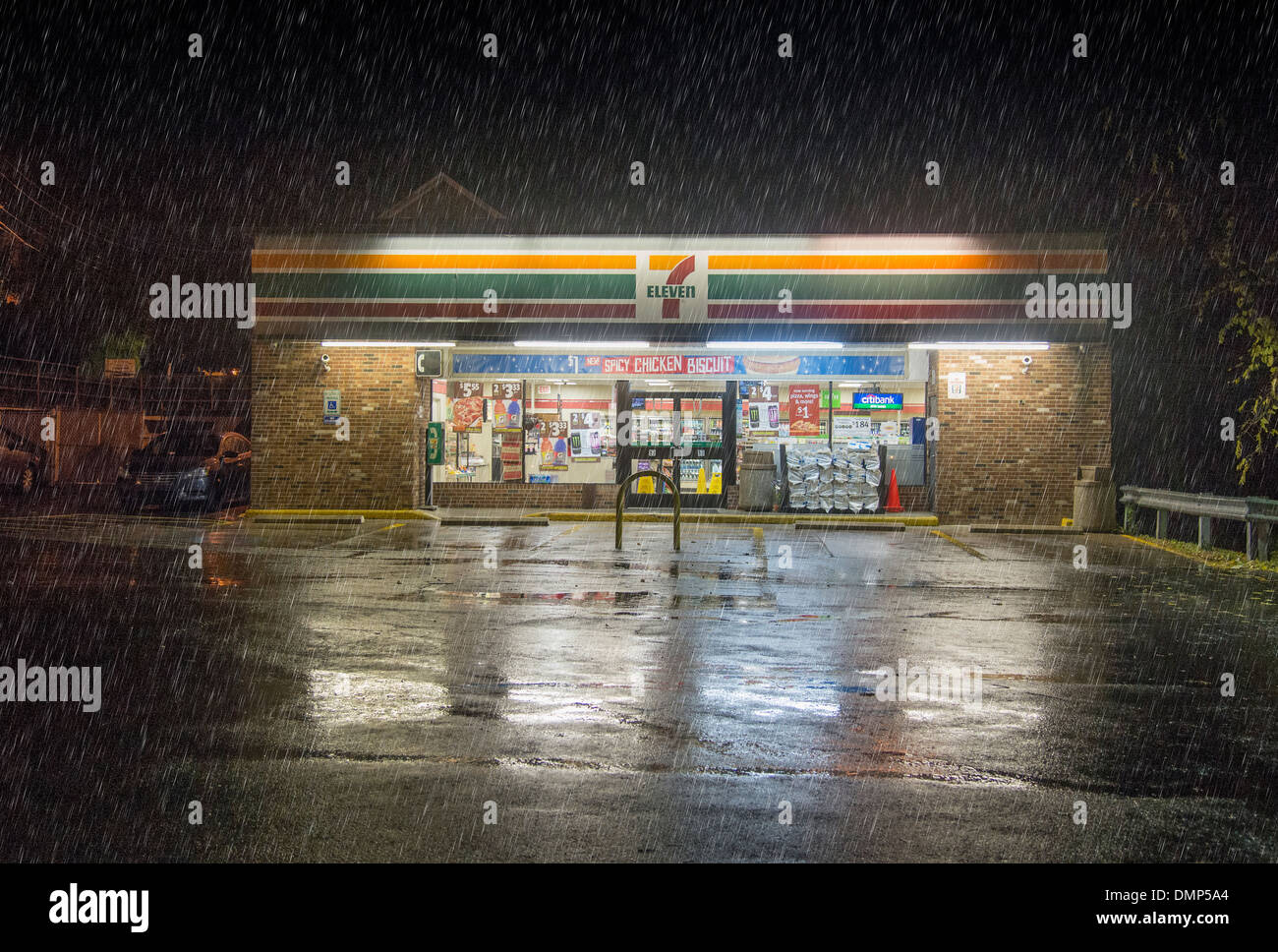 7-11 Convenience Store In The Rain at Night - Stock Image