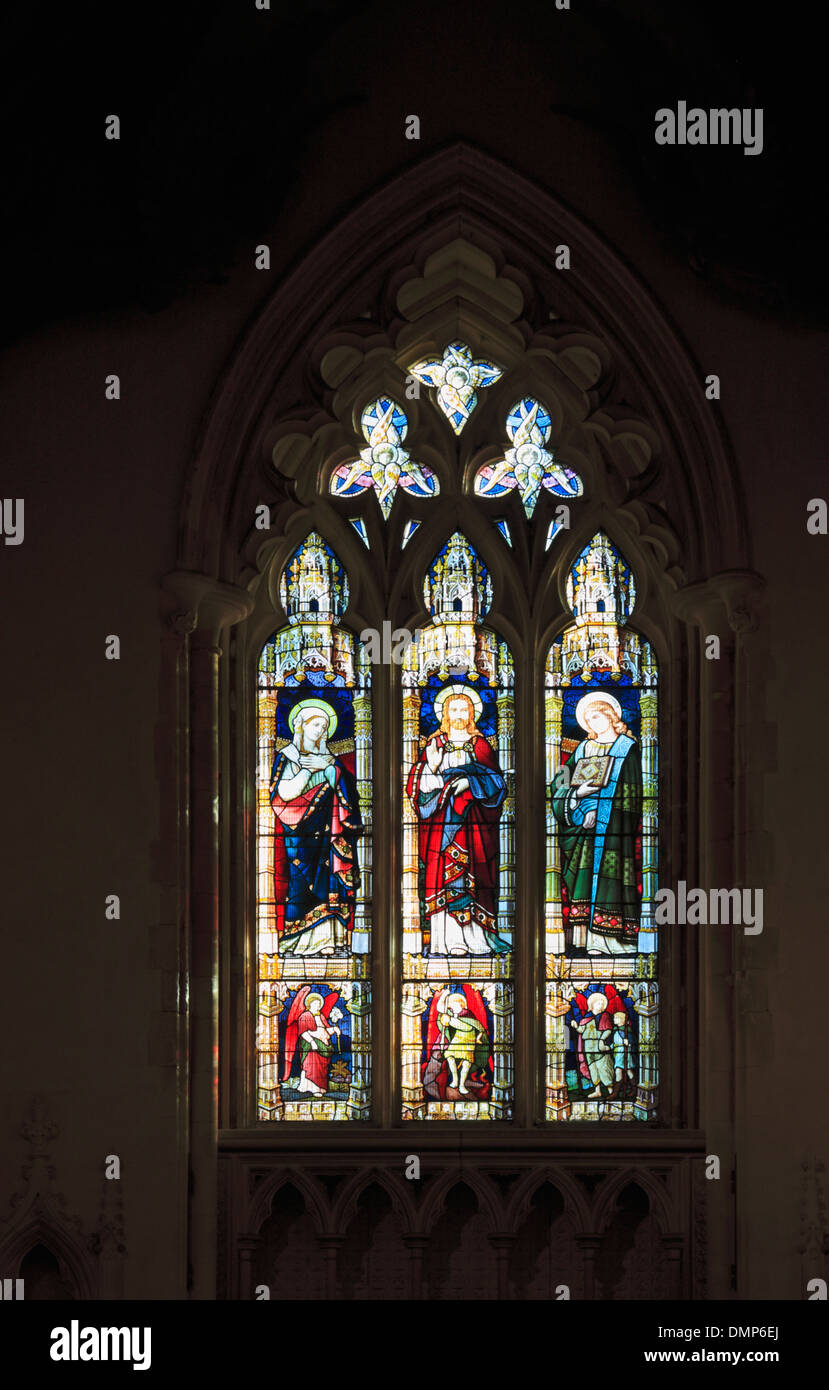 An example of a stained glass window in the parish church of St Michael and All Angels at Booton, Norfolk, England, UK. - Stock Image