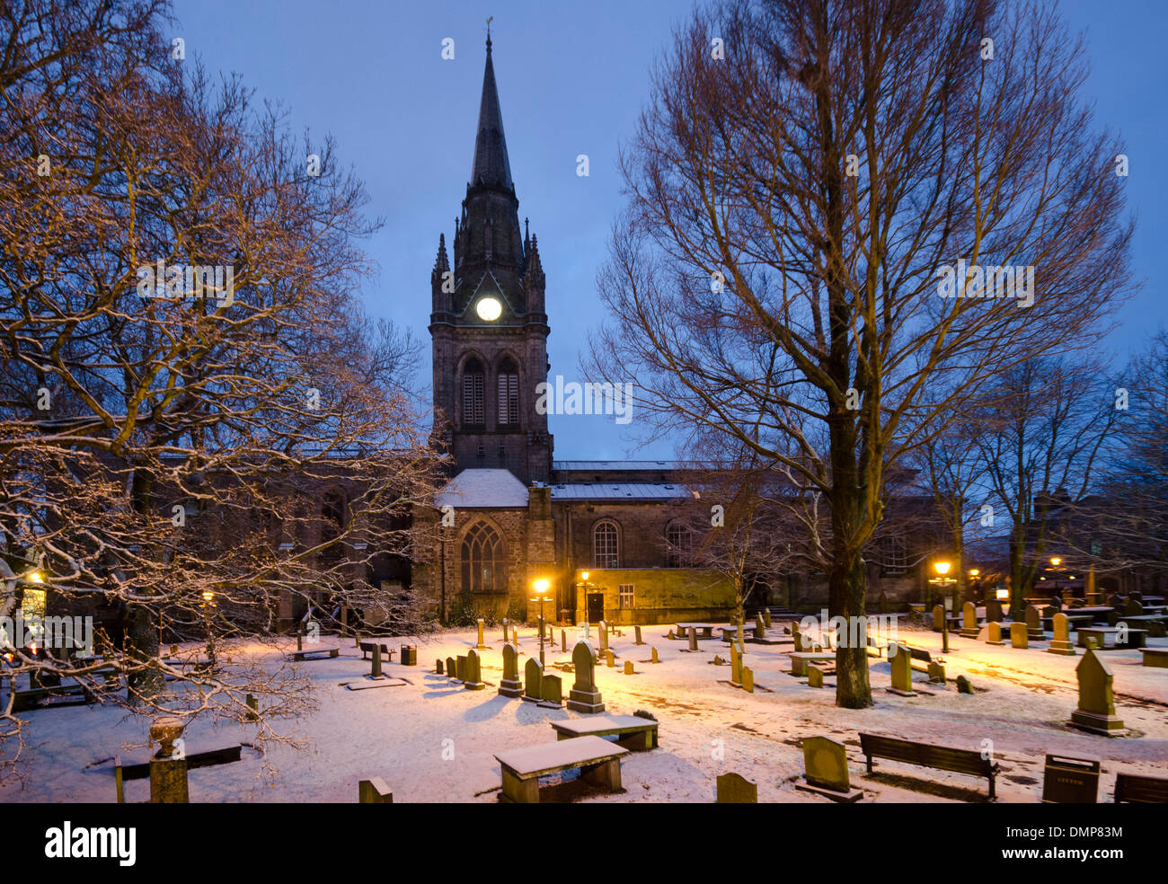 frosty floodlight snow cold kirk of st nicholas church - Stock Image