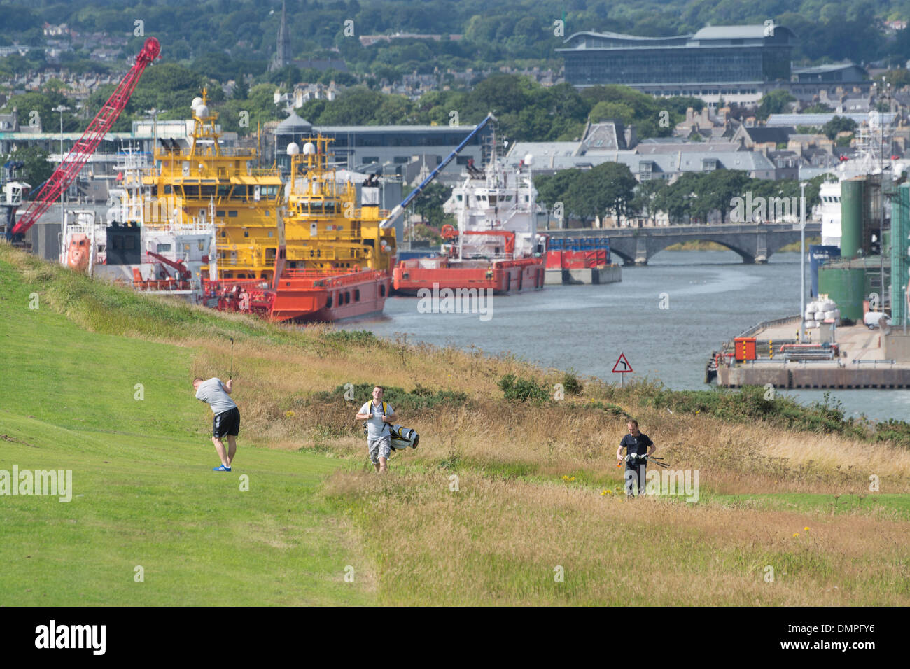 golf torry aberdeen golfers supply vessels - Stock Image