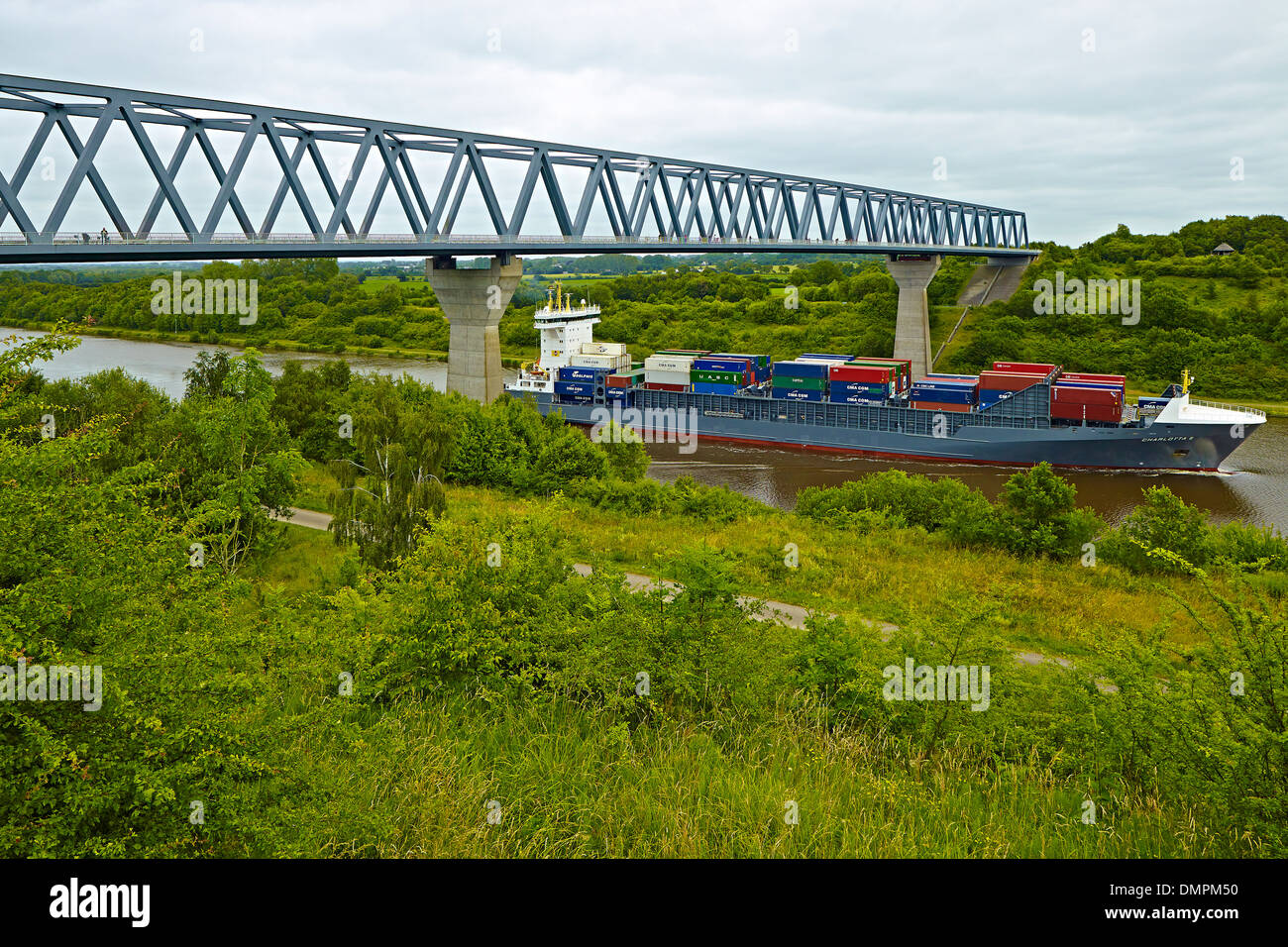 Container ship Charlotta B in the Kiel Canal near Albersdorf, district of Dithmarschen, Schleswig-Holstein, Germany - Stock Image
