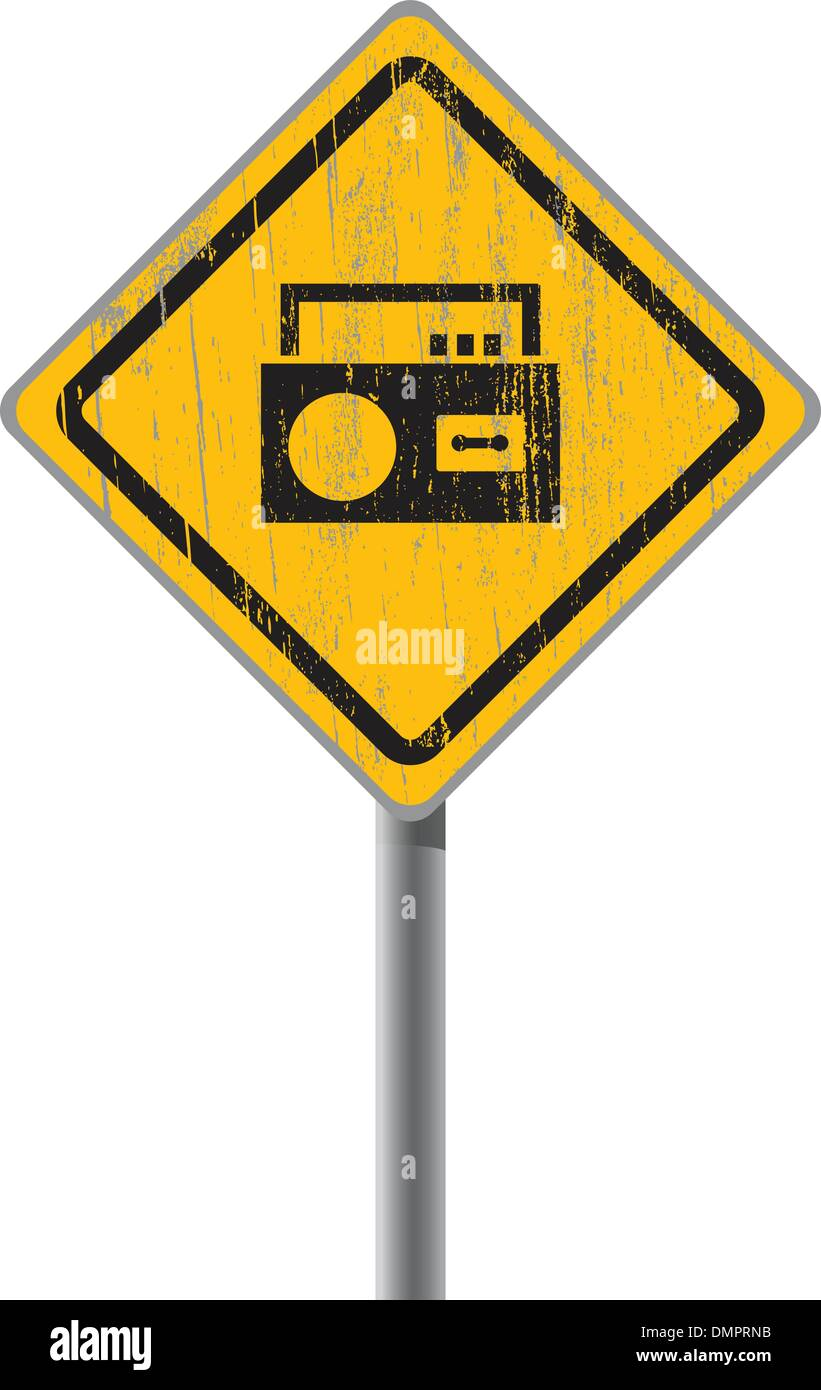 Old shabby yellow sign with an old-fashioned cassette recorder. - Stock Image