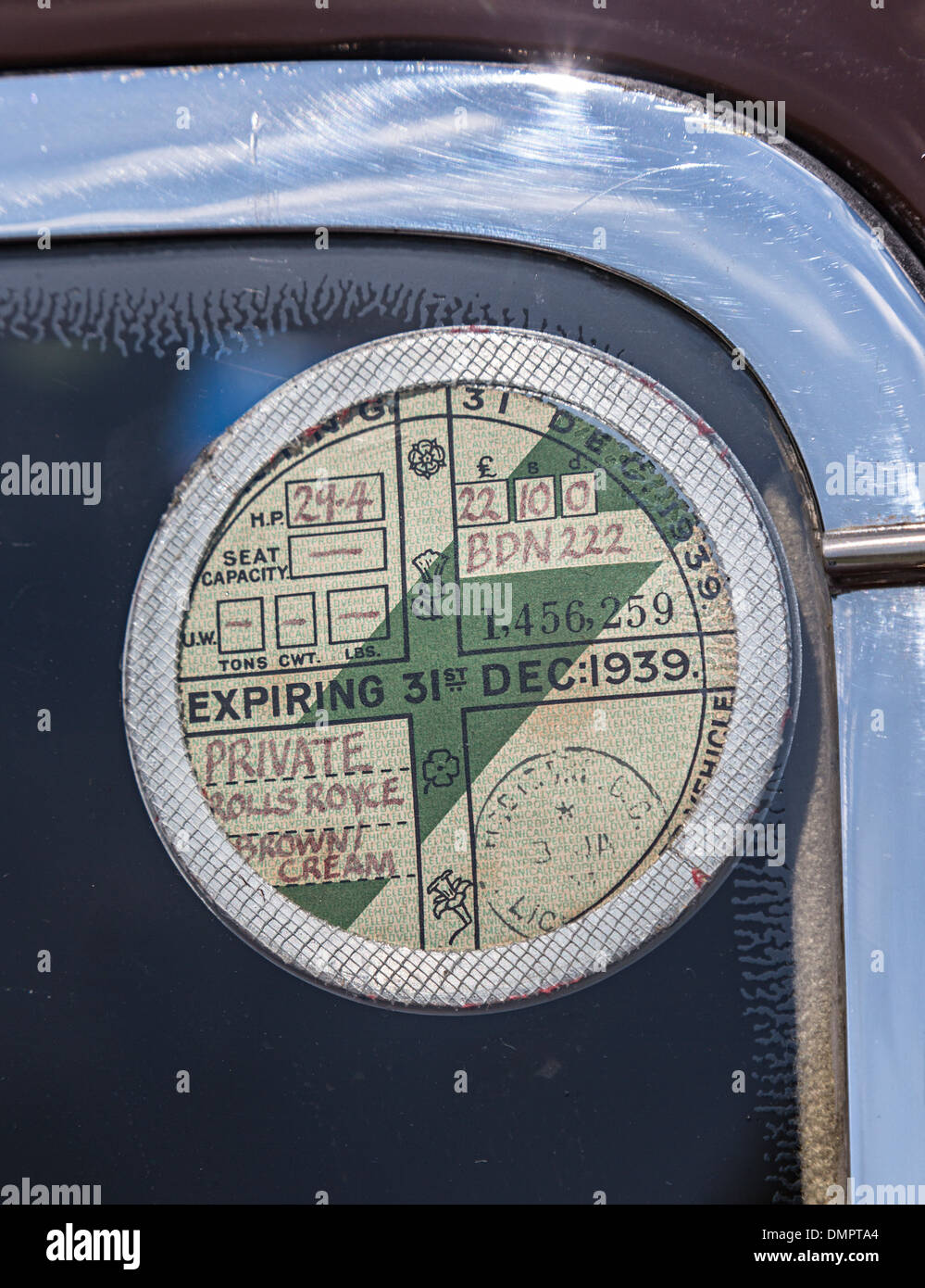 Old style 1939 tax disk on Rolls Royce car - Stock Image