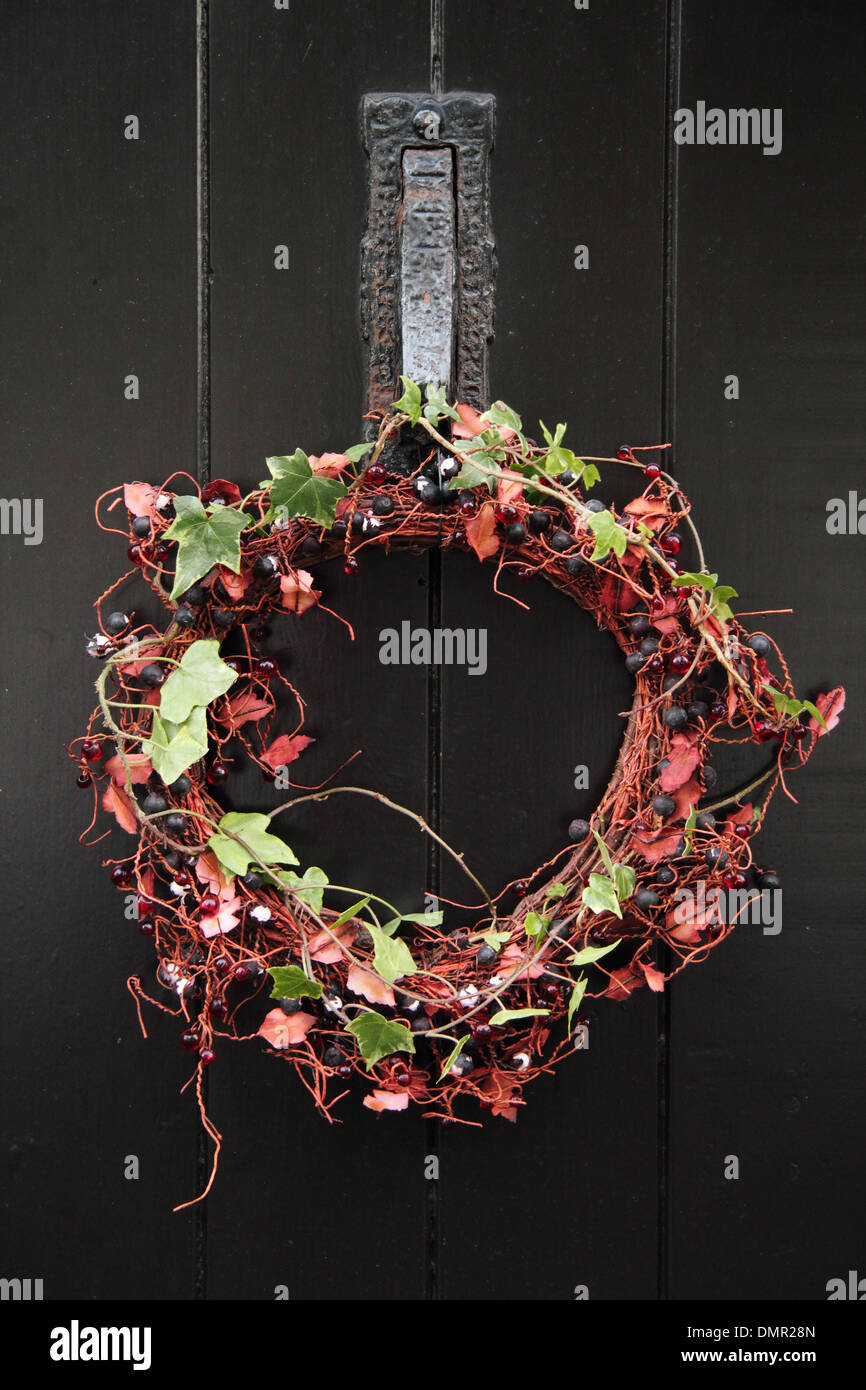Christmas Wreath Hanging On The Front Door Of An English Country Cottage In  The Village Of Eyam, Peak District, Derbyshire, UK