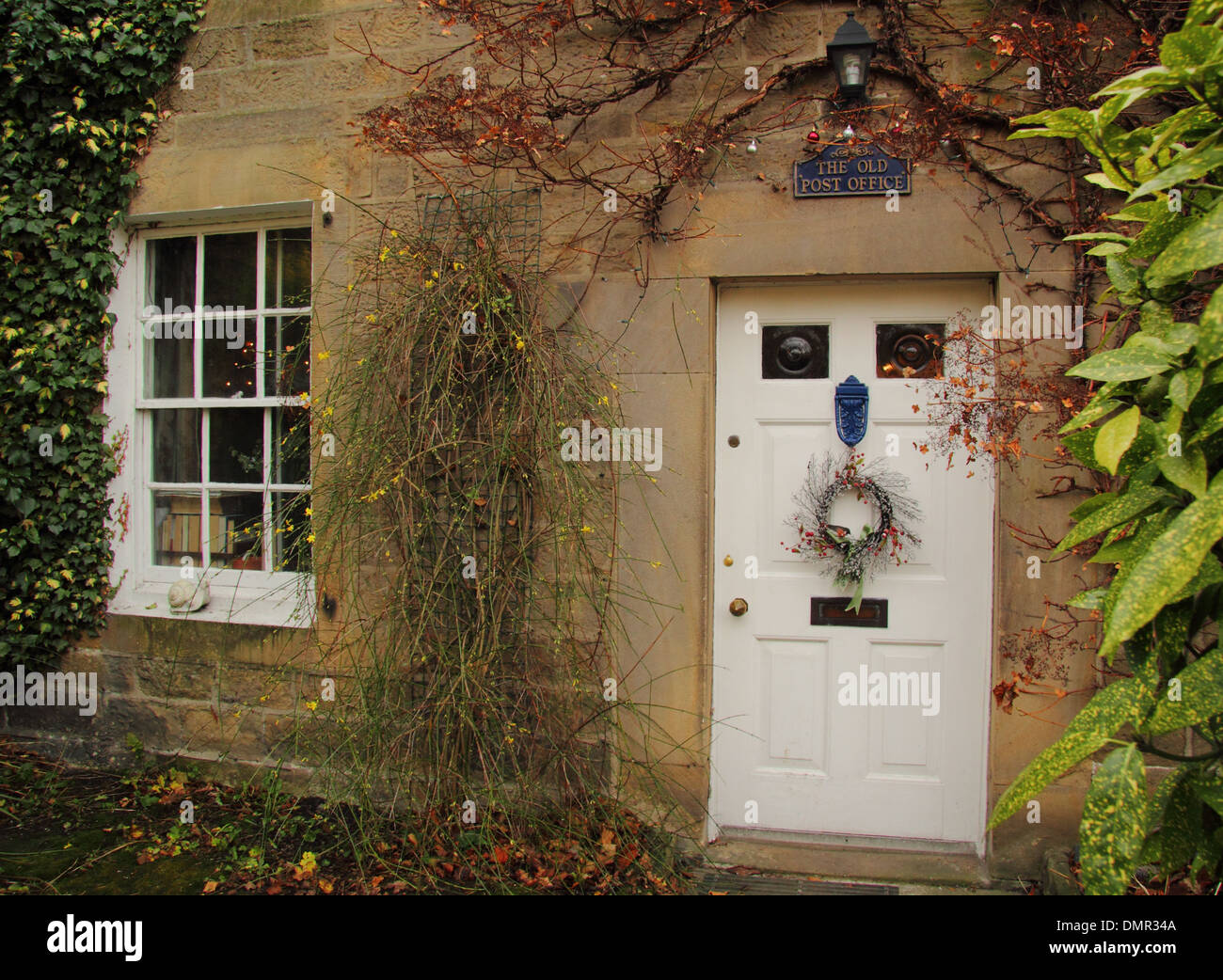 Christmas Wreath Hanging On Front Door Of Traditional English