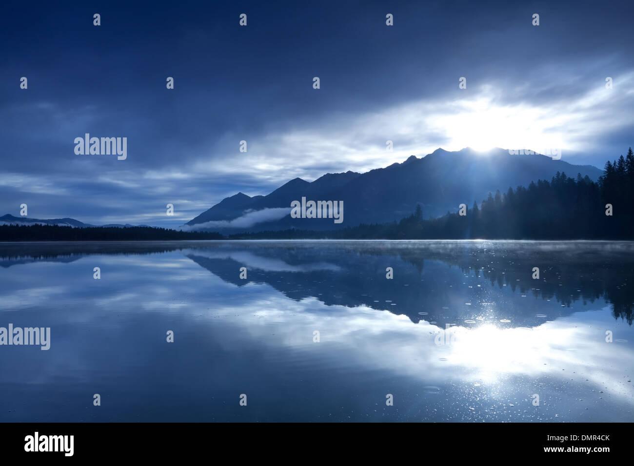 sunshine over mountains and alpine lake, Bavaria, Germany - Stock Image