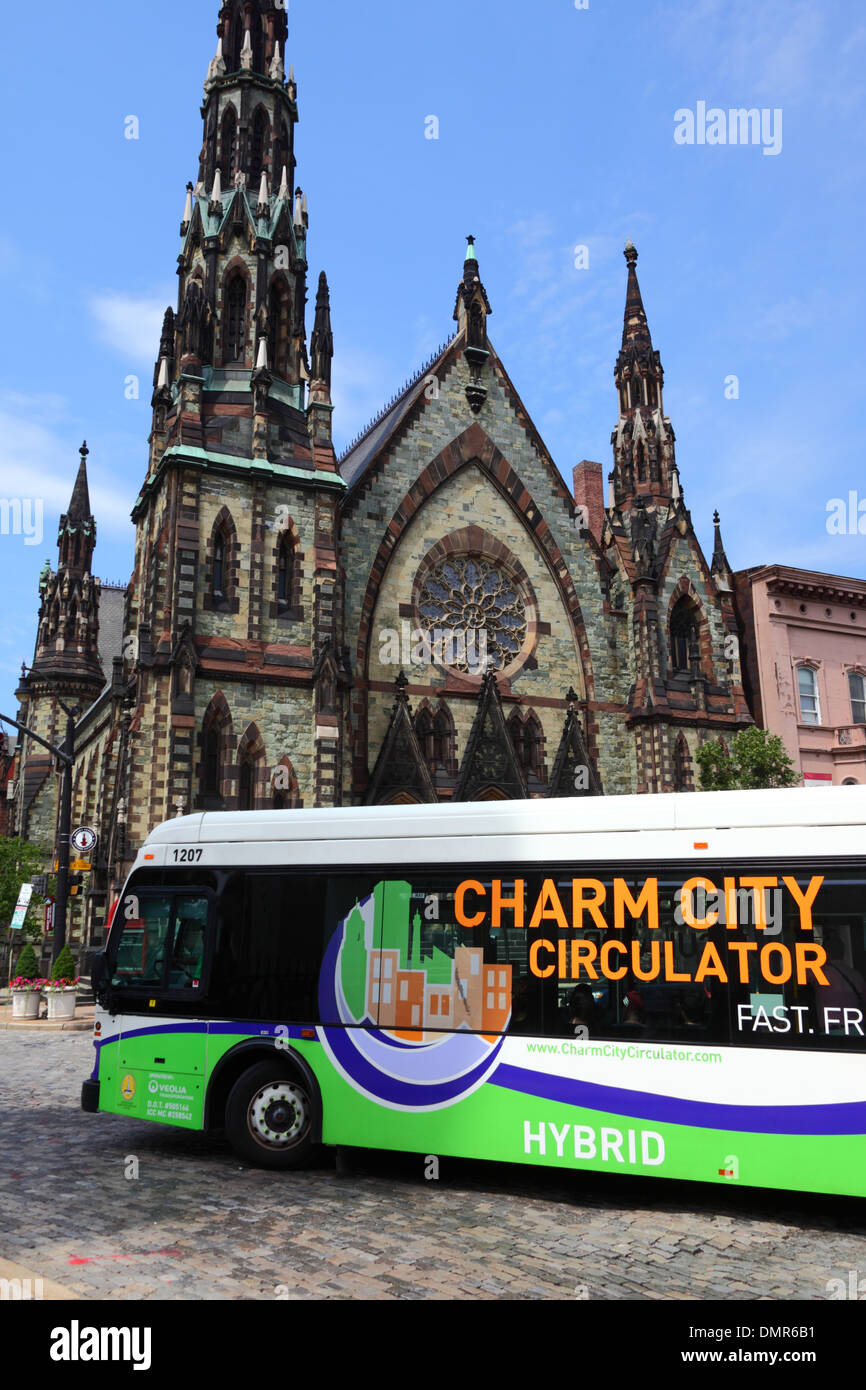 Charm City Circulator free public bus that uses hybrid fuel technology made by Orion International, Baltimore, Maryland, USA - Stock Image