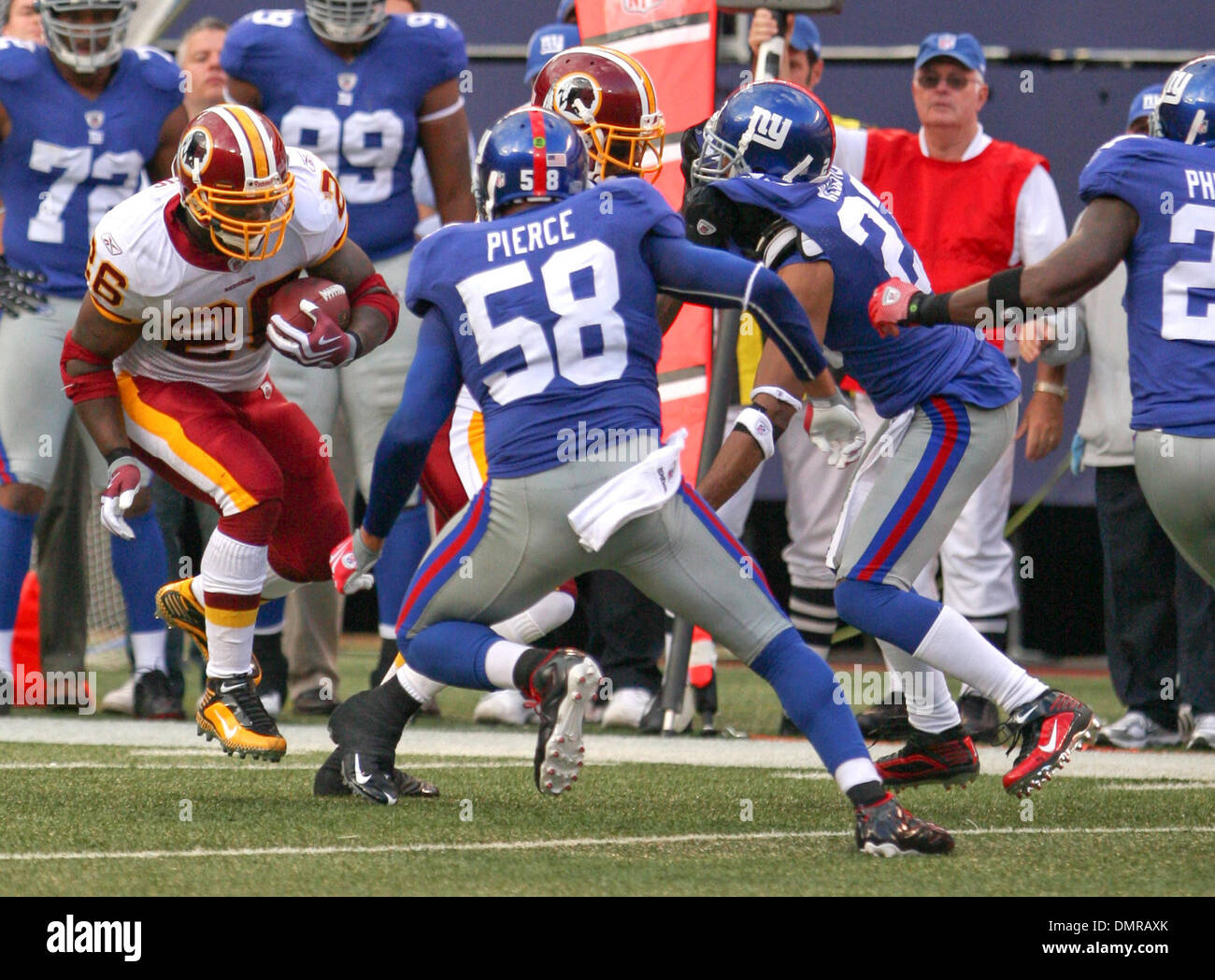 Redskins #26 Clinton Portis and NY's #58 Antonio Pierce. The New York Giants defeated the Washington Redskins 23-17 at Giants Stadium in Rutherford, New Jersey. (Credit Image: © Anthony Gruppuso/Southcreek Global/ZUMApress.com) - Stock Image
