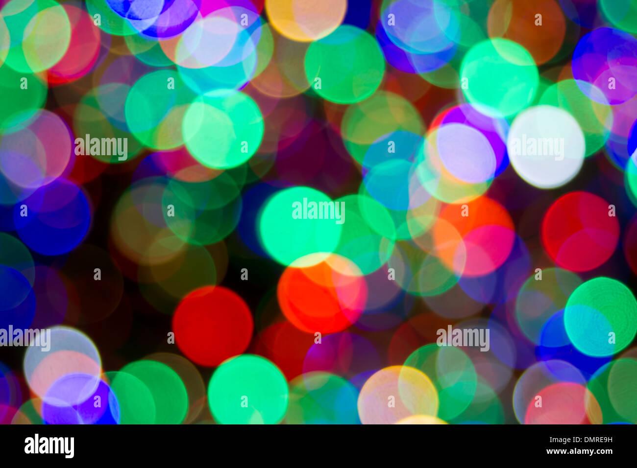 Christmas Tree Colorful Blinking Lights Blurred Defocused Bokeh Background - Stock Image