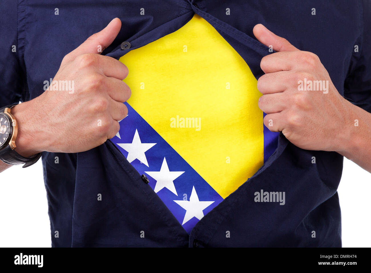 Young sport fan opening his shirt and showing the flag his country bosnia, bosnian flag - Stock Image