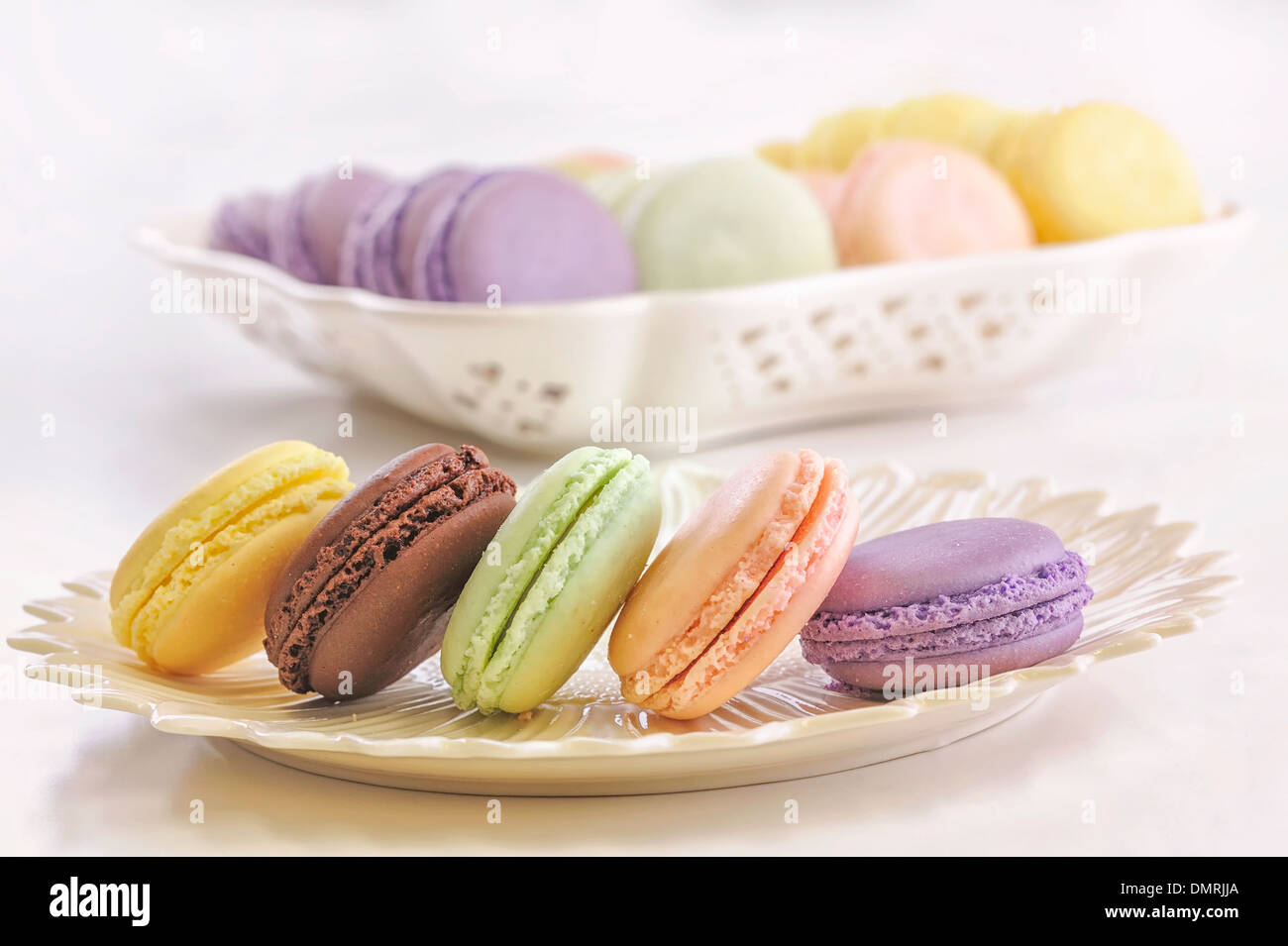 An assortment of cassis, citron, raspberry, chocolate and pistachio flavored macarons - Stock Image