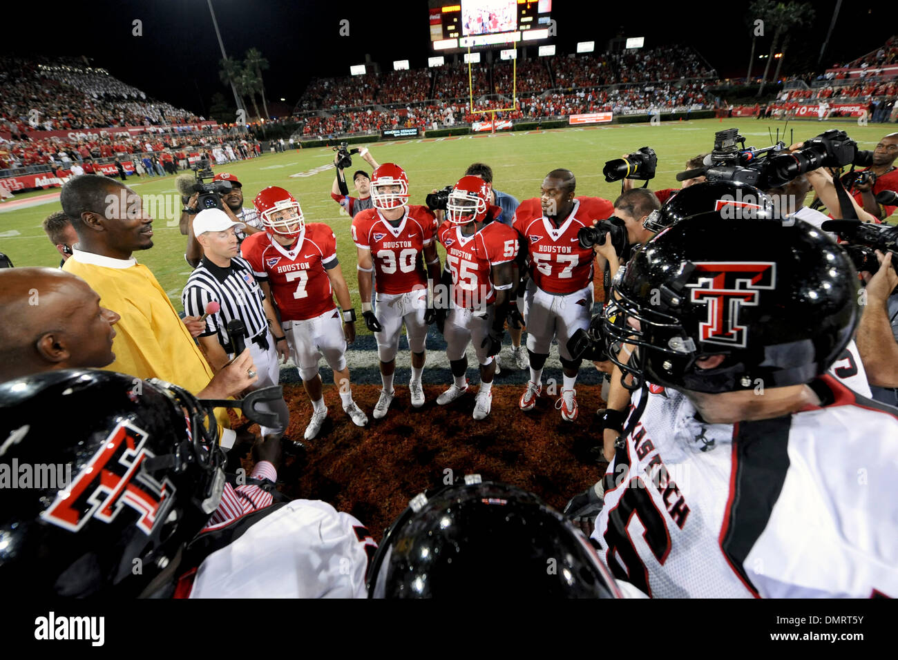 A battle between former SWC foes the Texas Tech Red Raiders travel to Houston to face the #17 ranked Houston Cougars for a shoot out!  Pregame coin flip between the visiting Red Raiders and Cougars. (Credit Image: © Steven Leija/Southcreek Global/ZUMApress.com) - Stock Image
