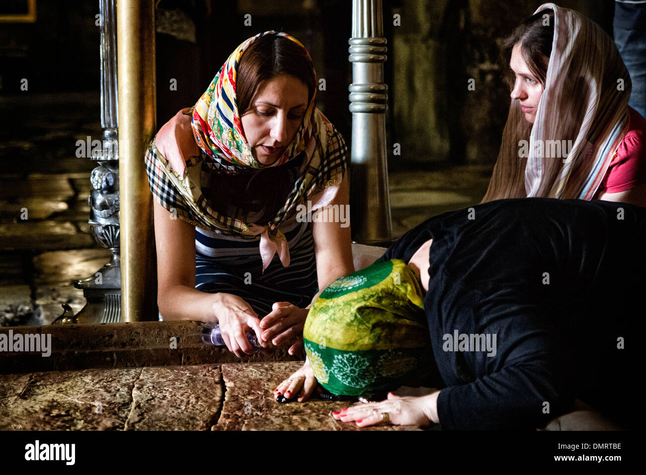 The Stone of Anointing, also known as The Stone of Unction inside the Church of the Holy Sepulchre. Stock Photo