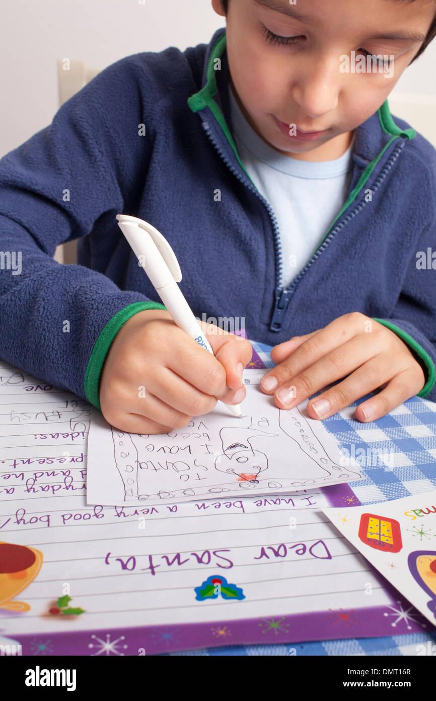 Boy writes letter to Santa - Stock Image