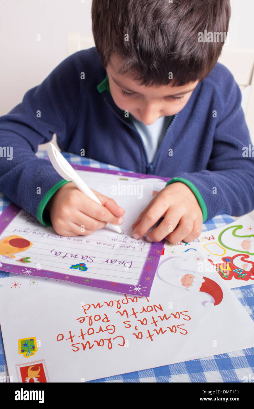 Boy Writes Letter To Santa Claus Stock Photo   Alamy