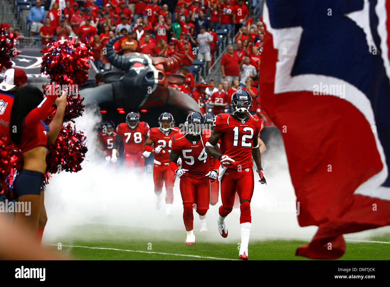 new concept d2b8b bcf72 The Houston Texans enter the field amid smoke and a red ...