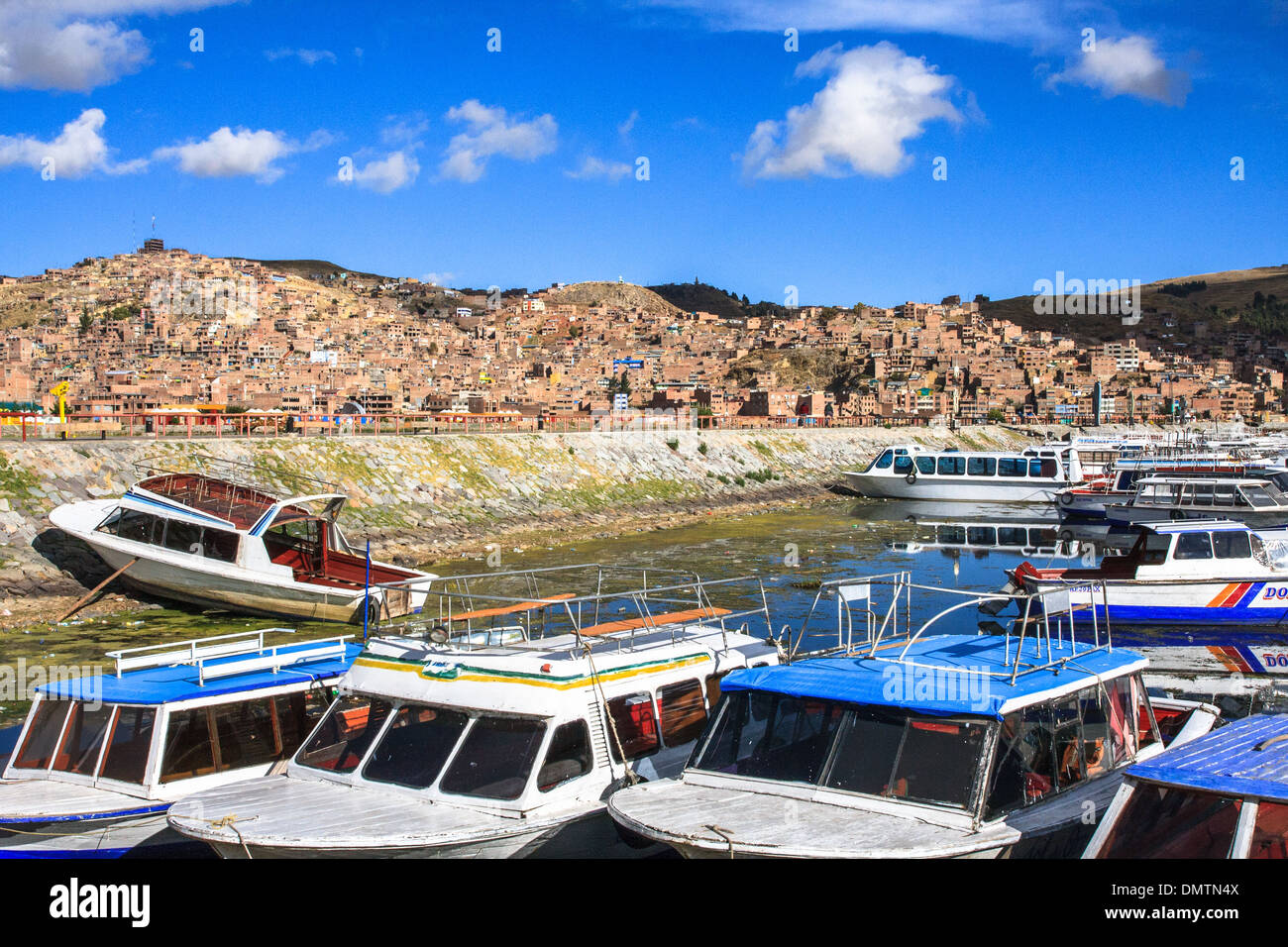 Tourist boats in the harbour of Puno on the titicaca lake - Stock Image