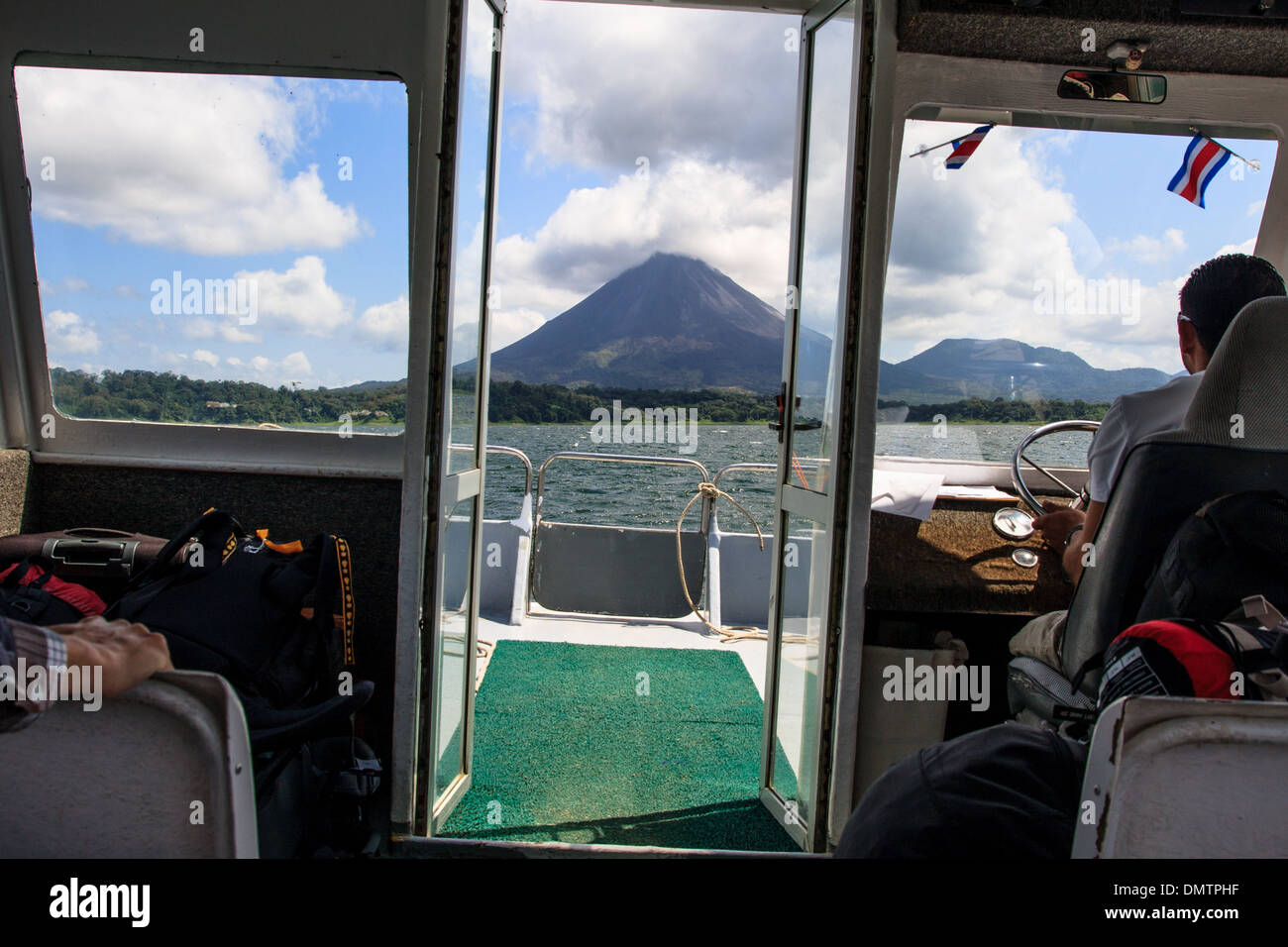 View of Arenal Volcano from lake Arenal, Costa Rica. - Stock Image