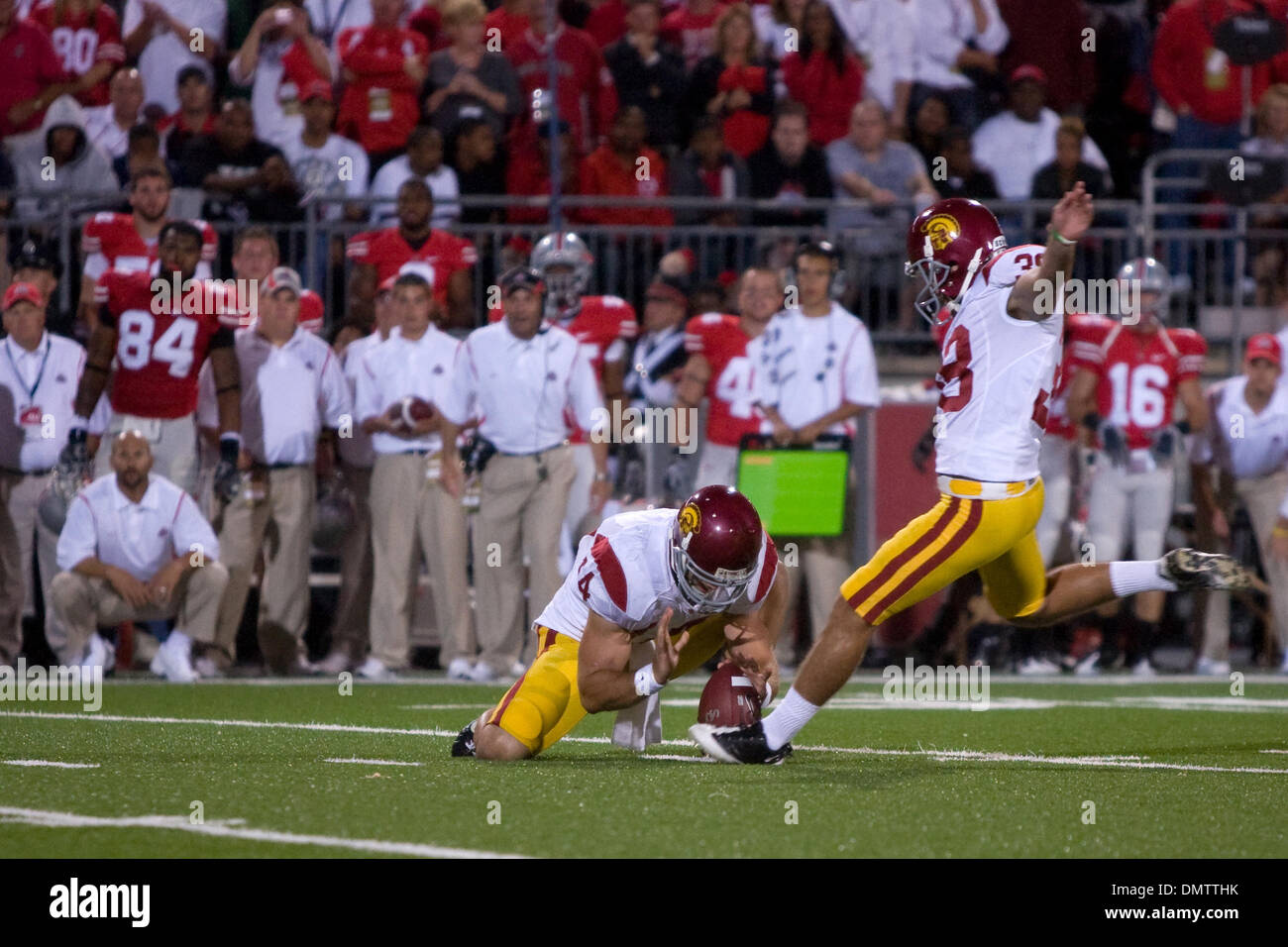 12 September 2009:  USC Trojans Jordan Congdon (38) attempts a field goal out of the hold of Garrett Green (14) during the NCAA college football game between the USC Trojans and the Ohio State Buckeyes at Ohio Stadium in Columbus, Ohio.  CongdonÕs field goal was no good but the #3 USC Trojans rallied to defeat #7 Ohio State 18-15 before a record crowd of 106,033 fans at Ohio Stadi - Stock Image