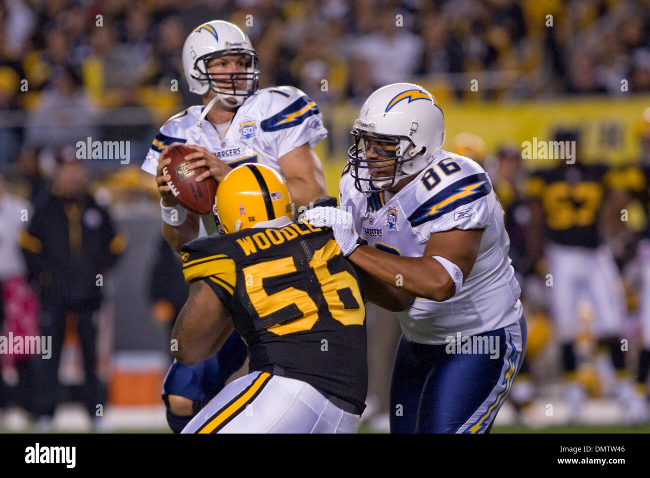 1e89f8c01ff 04 October 2009  Pittsburgh Steelers LaMarr Woodley (56) rushes San Diego  Chargers quarterback