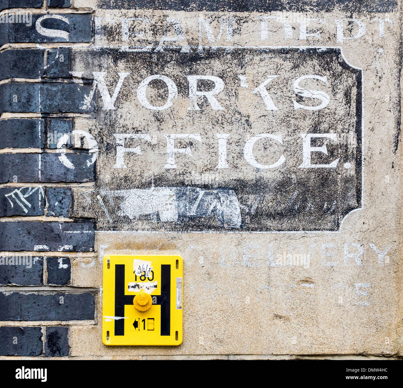 'Steam Dept. Works Office' - Old sign on wall of brick building in Fashion Street, London, UK - Stock Image