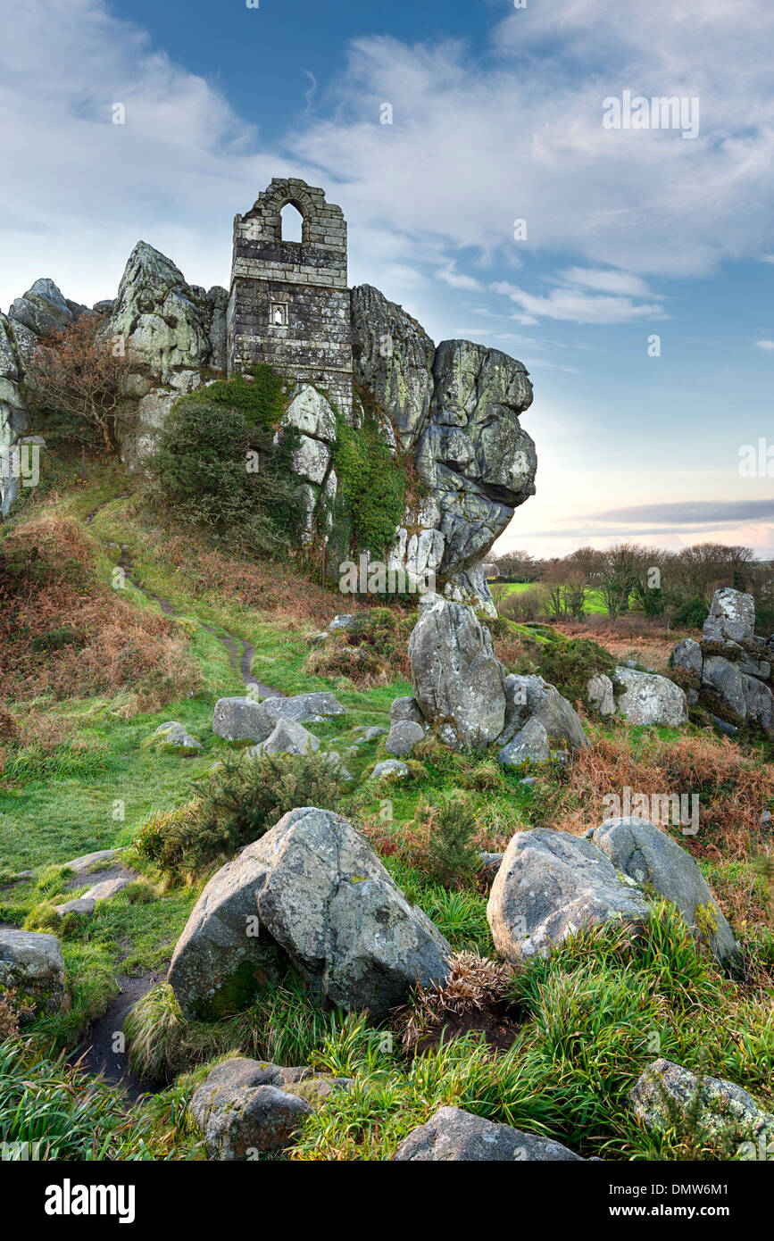 An ancient ruined chapel built in to a craggy granite tor at Roche Rock in Cornwall - Stock Image