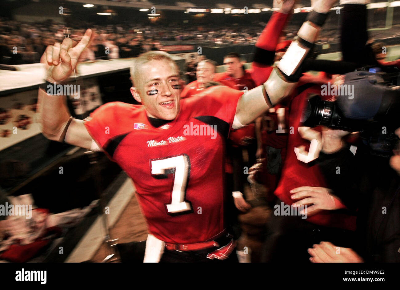 Dec 07, 2002; Oakland, CA, USA; Monte Vista High's quarterback #7 Kyle Wright (cq) celebrates with teammates after winning their NCS 3A football championship game against San Ramon Valley High held at the Network Associates Coliseum in Oakland, Calif., on Saturday, December 7, 2002. Monte Vista won the game 35-14. - Stock Image