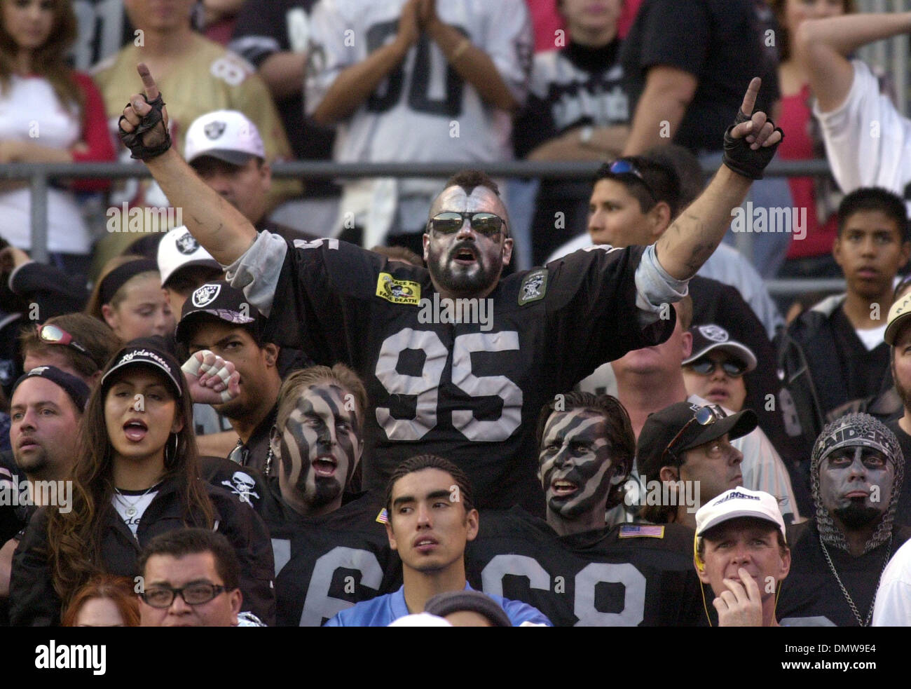 Dec 08, 2002; San Diego, CA, USA; Oakland Raider fans almost out number San Diego Charger fans as they start celebrating in the final minutes of the 4th quarter of their game against the San Diego Chargers on Sunday, December 8, 2002 at Qualcomm Stadium in San Diego, Calif. Oakland beat San Diego 27-7. - Stock Image