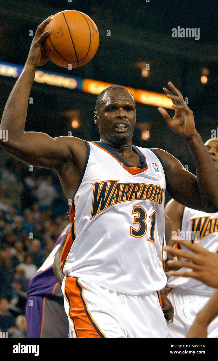 Dec 30, 2002; Oakland, CA, USA; Golden State Warriors Adonal Foyle, cq, grabs an offensive rebound during game versus the Phoenix Suns at The Arena in Oakland, Calif. on Saturday November 30, 2002. Foyle had eight rebounds and scored two points as the Warriors beat the Suns 100-90. - Stock Image