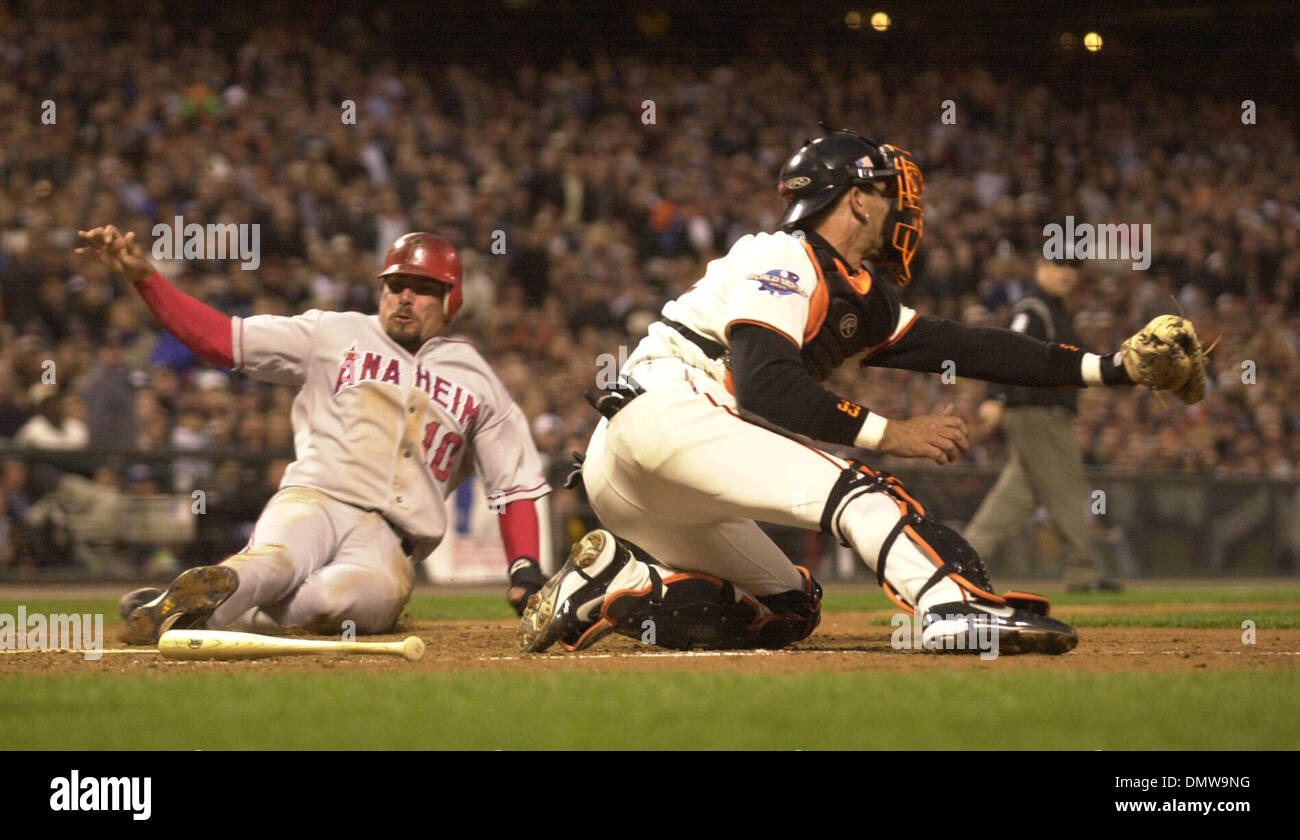 Oct 23, 2002 - San Francisco, CA, USA - BENJI GIL of the Anaheim Angels slides safely across home plate as Giants catcher Benito Santiago waits for the throw during second inning action of game 4 of the 2002 World Series on Wednesday October 23, 2002 at Pac Bell Park in San Francisco Calif.  (Credit Image: © Karl Mondon/Contra Costa Times/ZUMA Press) RESTRICTIONS: USA Tabloids RIGH - Stock Image