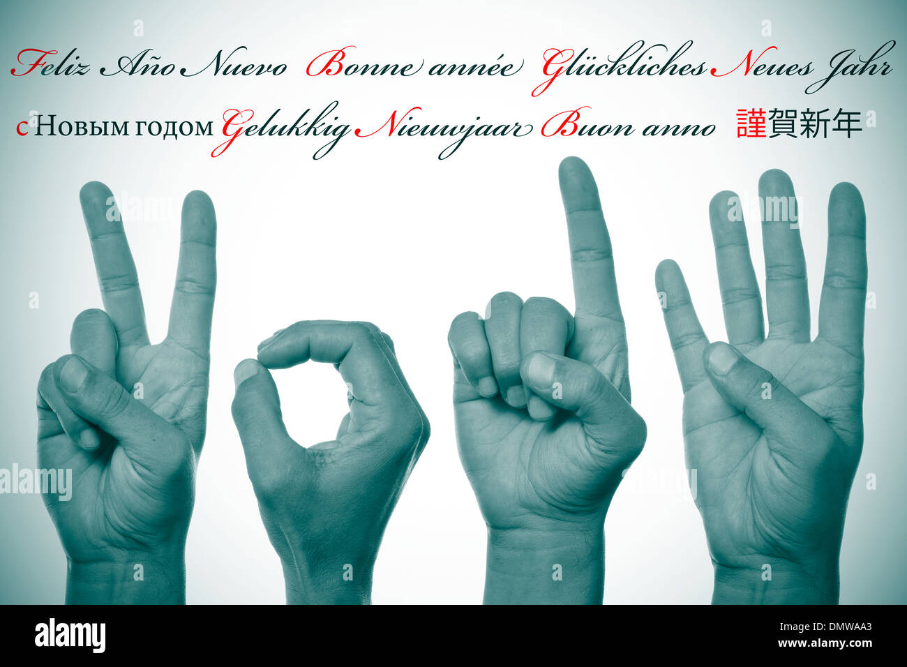 sentence happy new year written in different languages, such as spanish, french, german, russian, dutch, italian and japanese, a - Stock Image