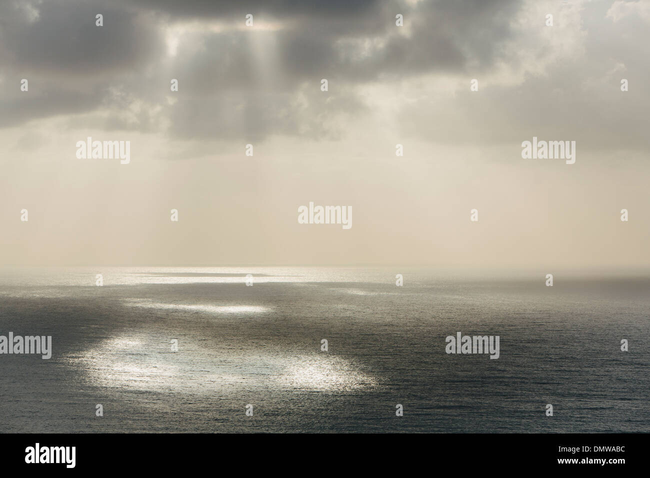 Shafts of sunlight shining through cloud and a view over  Pacific Ocean at Manzanita Oregon. Stock Photo