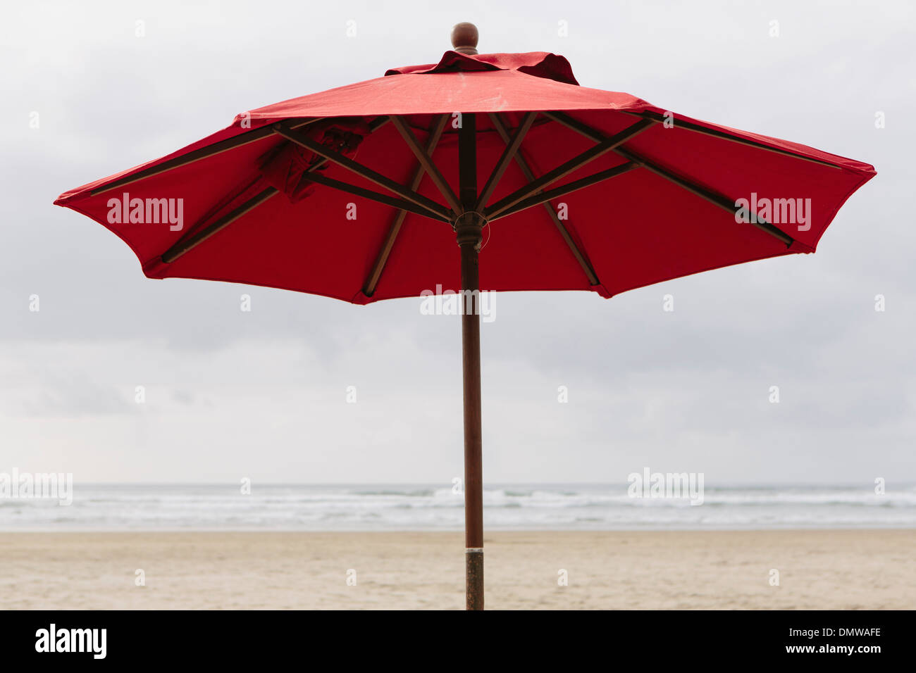 A large beach umbrella on  beach at Manzanita on  Pacific Ocean in Oregon. - Stock Image