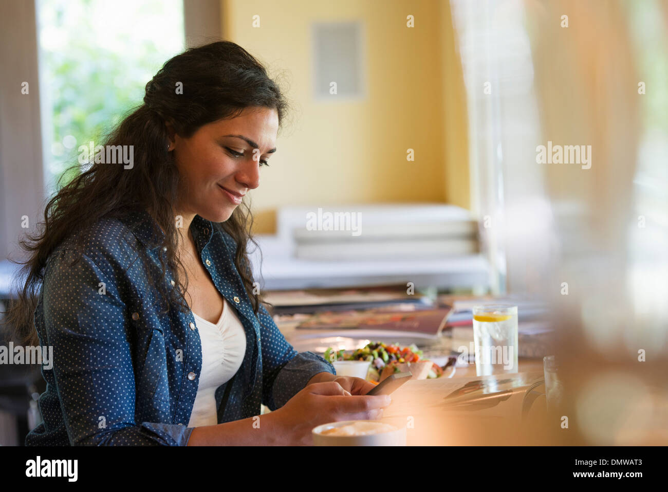 A woman using a smart phone. - Stock Image