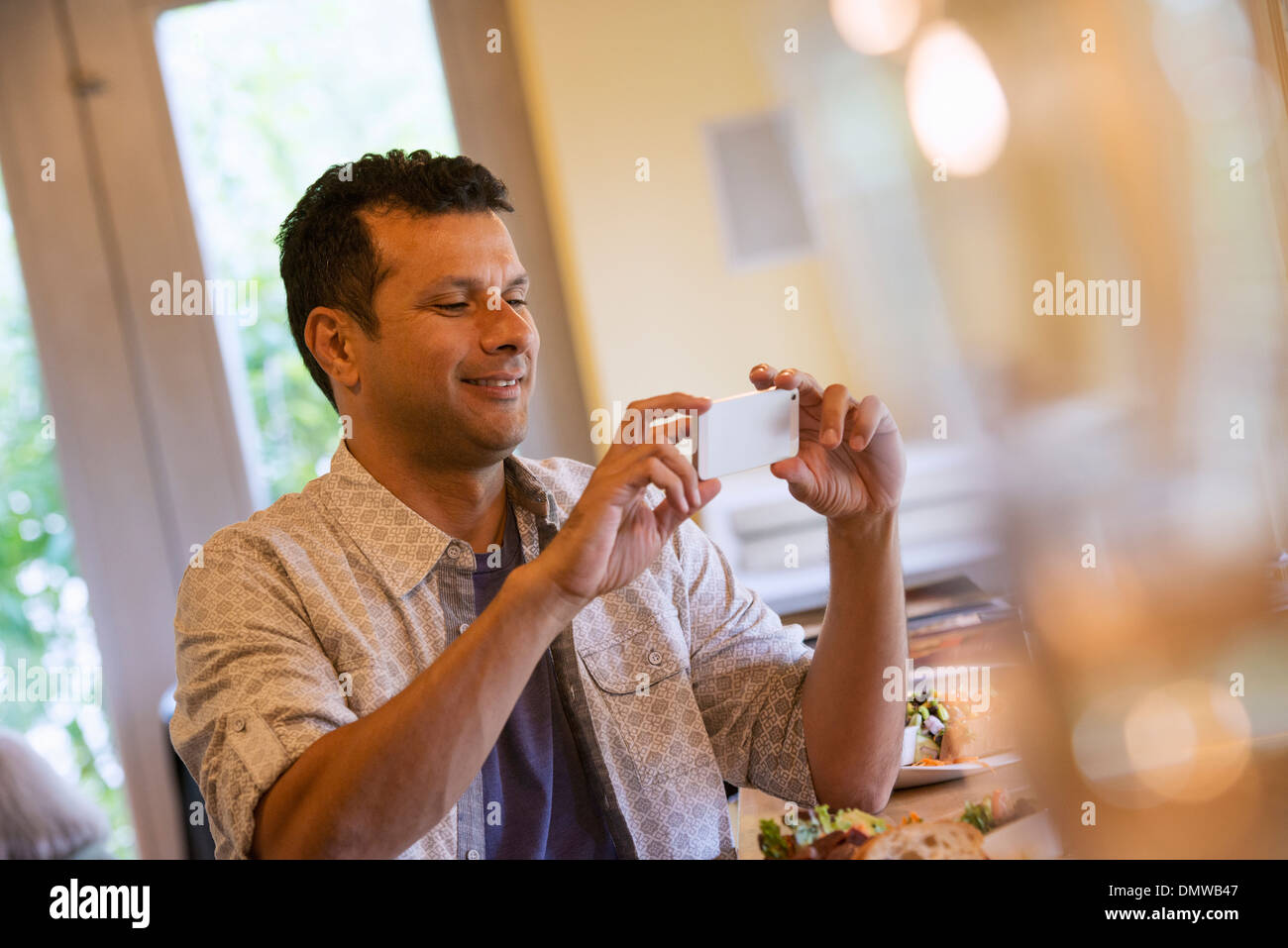 A small holding up a small smart phone. - Stock Image