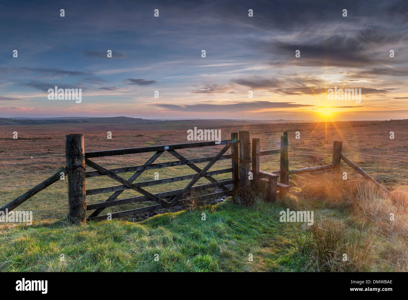 Old wooden five bar field gate and stile on windswept moorland at Bodmin Moor in Cornwall Stock Photo