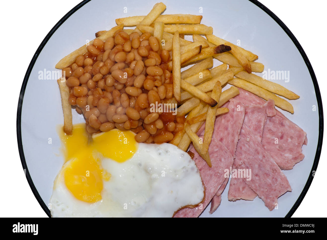 French Fries baked Beans Spam and Fried Egg Meal on a Plate - Stock Image