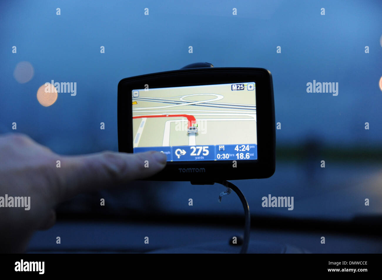 TomTom Sat nav being used in a car for navigation Stock Photo