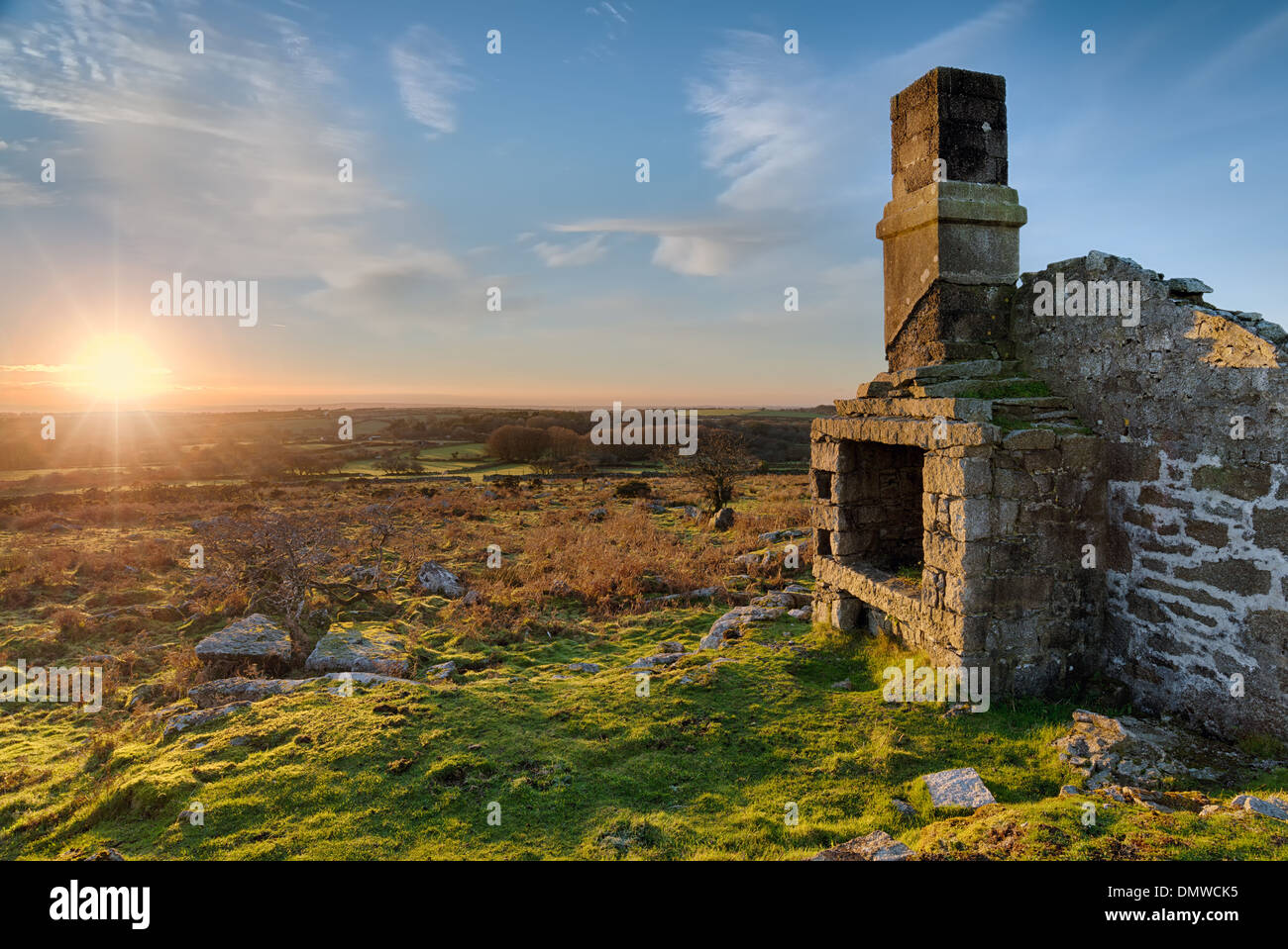 Sunset over ruins Carbilly Tor on Bodmin Moor in Cornwall - Stock Image