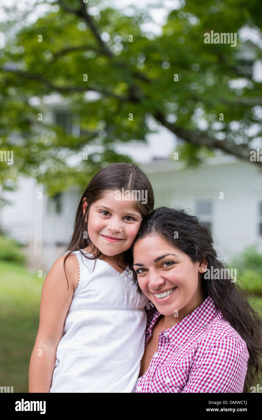 A mor and daughter in a country garden. - Stock Image