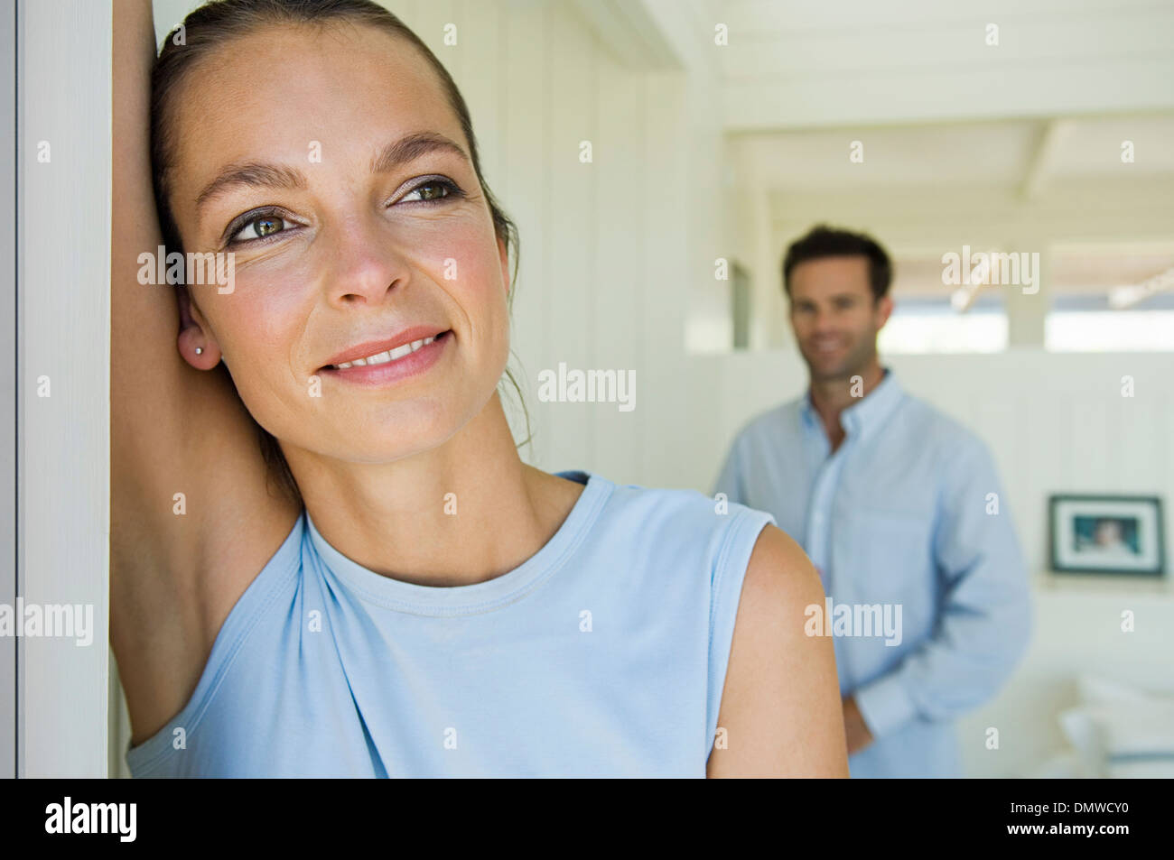 A young couple a woman and a man at home. - Stock Image
