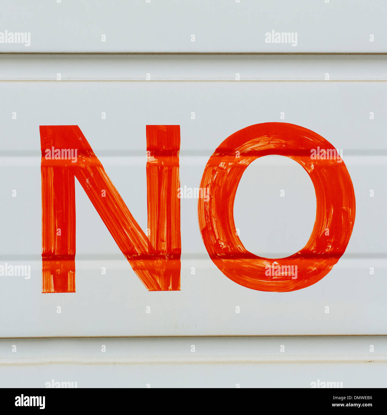 A large NO sign in red paint on a garage door indicating No Parking. - Stock Image