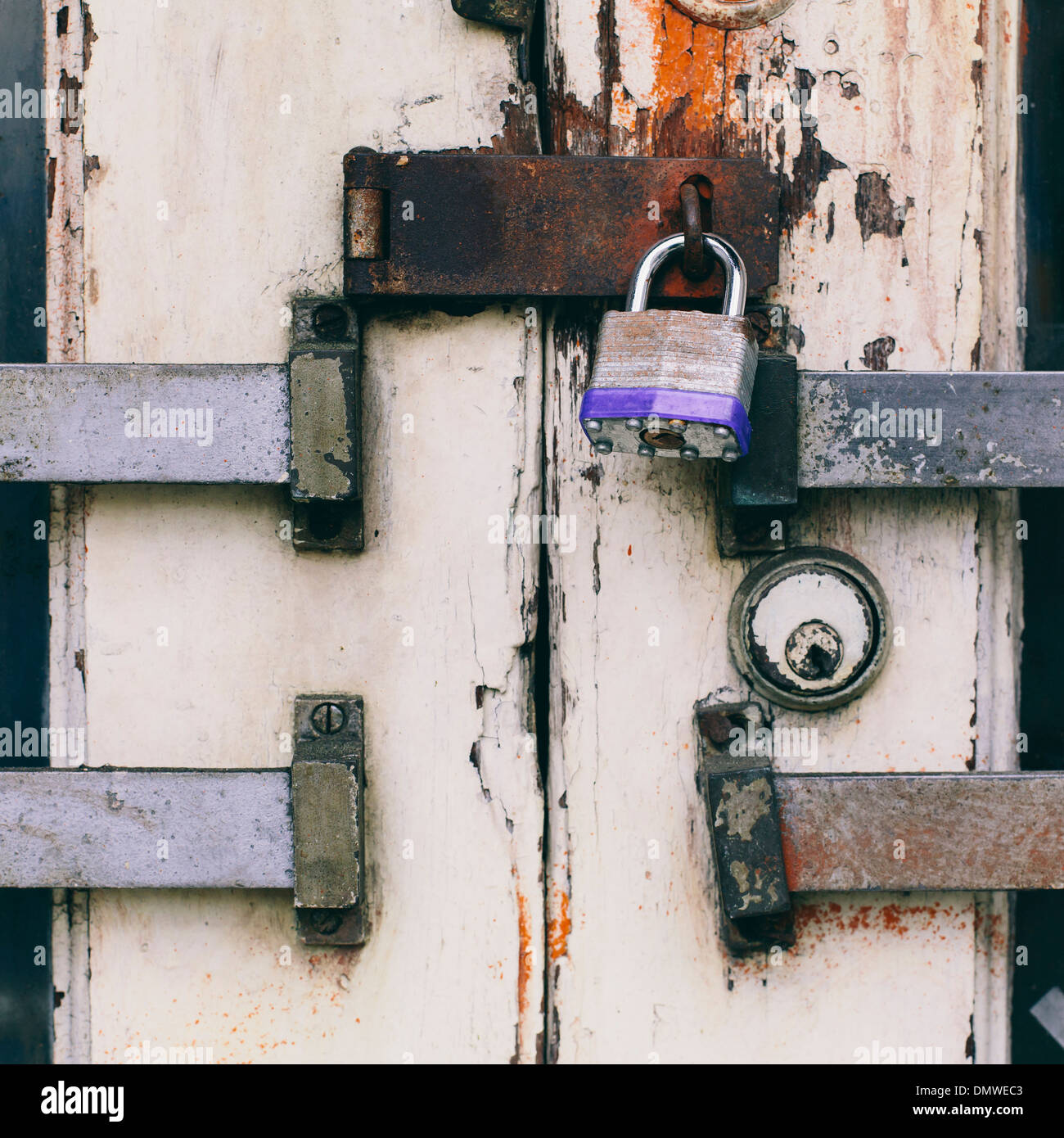 Close up of a padlocked and bolted door. - Stock Image